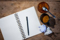 Notebook paper coffee and crumpled paper pen on wood table Stock Photo