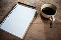 Notebook paper and coffee pen on wood table Royalty Free Stock Photo