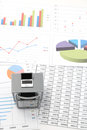 Notebook PC and business documents with numbers and charts. Royalty Free Stock Photo