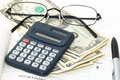 Notebook with pen, calculator, cheque book, cash and glasses Royalty Free Stock Photo