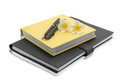 Notebook with pen and flower on a white background isolate Royalty Free Stock Image
