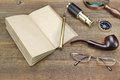 Notebook, Pen, Magnifier, Cpmpass, Pipe, Spyglass On Wood Backgr Royalty Free Stock Photo