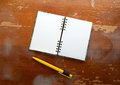 Notebook and pen on wood background Royalty Free Stock Photos