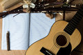 Notebook and pencil on guitar,Writing music Royalty Free Stock Photo