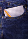 Notebook and pencil in a jeans pocket Stock Image