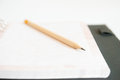 Notebook and pencil on white background Royalty Free Stock Photos