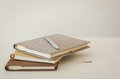 Notebook and pencil on white table Royalty Free Stock Image