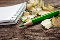 Notebook with pensil and pencil shavings on wooden background Stock Photos
