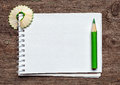 Notebook with pensil and pencil shavings on wooden background Stock Images