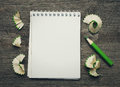 Notebook with pensil on wooden background Stock Photos