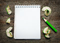 Notebook with pensil on wooden background Royalty Free Stock Photo