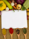 Notebook for recipes with vegetables and spices Royalty Free Stock Image