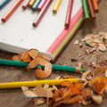 Notebook and sharpened colour pencils pencil shavings a Royalty Free Stock Image