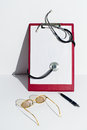 Notebook and stethoscope Stock Photography