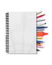 Notebook and suplies pens pencils on white background Royalty Free Stock Images