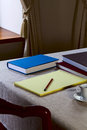 Notebook on the table with a pencil and books Royalty Free Stock Images
