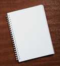 Notebook on wood background. Royalty Free Stock Photos