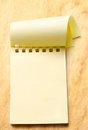 Notepad on aged paper background Stock Photography