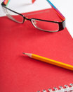 Notepad glasses and a pencil jotter composition Royalty Free Stock Images