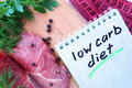 Notepad with low carb diet and fresh meat Royalty Free Stock Photo