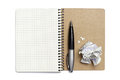 Notepad pen and crumpled paper opened on white background Stock Photo