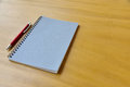 Notepad and a pencil on wooden desk background Royalty Free Stock Photo