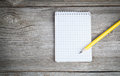 Notepad with pencil on a wooden table Royalty Free Stock Images