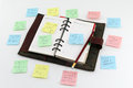 Notepad with postit about stress an open some colorful notes attached around Royalty Free Stock Photography