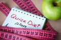 Notepad with quick diet and measuring tape Royalty Free Stock Images
