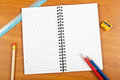 Notepad with stationery and on a table copy space Royalty Free Stock Images