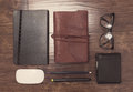 Notepads in leather cover with pencils and eyeglasses Royalty Free Stock Photo