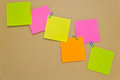 Notepaper postit color message with the paper clips on a dark background Stock Photography