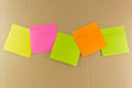 Notepaper postit some color adhesive message on a dark background Royalty Free Stock Photo