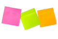 Notepaper postit three color adhesive message on a white background Royalty Free Stock Images