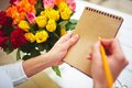 Notes of florist hands making in notepad Stock Photos