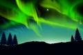 Nothern lights aurora boraaiis over mountains Royalty Free Stock Photo