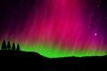 Nothern lights aurora boraaiis over mountains Stock Images