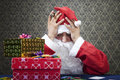 Nothing left santa loses all his gifts at the poker table Stock Image