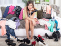 Nothing to wear concept, young woman deciding what to put on Royalty Free Stock Photo
