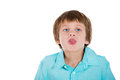 A notorious young boy sticking out tongue closeup portrait of adorable kid at camera gesture isolated on white background with Royalty Free Stock Images