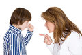 Notorius kid closeup portrait women pointing finger at boy because he did something wrong go to room is defiant fist up isolated Royalty Free Stock Images