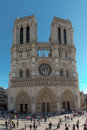 Notre dame cathedral in the city of paris france visitors and tourists gather front europe Stock Image