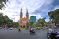 Notre dame cathedral hcmc vietnam jan motorbike passing the in ho chi minh city during rush hour Stock Photo