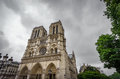 Notre Dame Cathedral in Paris with dark clouds Royalty Free Stock Photo