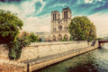 Notre Dame Cathedral in Paris, France and the Seine river. Vintage Royalty Free Stock Photo