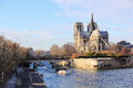Notre dame cathedral of paris the seine and the Royalty Free Stock Images