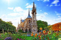 Notre dame de paris cathedral garden with flowers france Royalty Free Stock Image