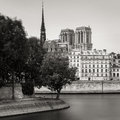Notre Dame de Paris Cathedral towers and Seine River bank Royalty Free Stock Photo