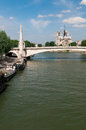 Notre dame de paris famous cathedral with bridge and river france Royalty Free Stock Photo
