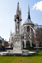 Notre dame de paris and fountain of the virgin from square jean xxiii in paris Royalty Free Stock Photo